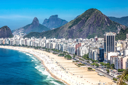 The white sands of Copacabana Beach stretch before Rio de Janeiro